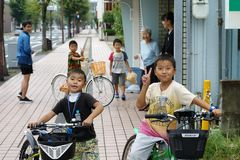 Saga, Japan:September 1,2018 - Portrait group of Japanese boys with their bicycles after school. Liefstyle of Japanese children in stock photography