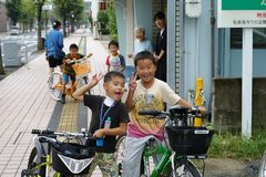 Saga, Japan:September 1,2018 - Portrait group of Japanese boys with their bicycles after school. Liefstyle of Japanese children in stock photos