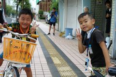 Saga, Japan:September 1,2018 - Portrait group of Japanese boys with their bicycles after school. Liefstyle of Japanese children in stock photo