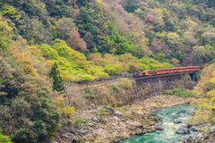 Sagano Romantic train running above river Kyoto Japan. Sagano Romantic train is running beside the cliff above river in Kyoto prefecture Japan Royalty Free Stock Photo