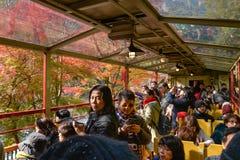 Sagano sightseeing train, Kyoto, Japan. Kyoto, Japan - November 17, 2016: Many tourists enjoy sightseeing on Sagano romantic train, Kyoto, Japan Stock Photos