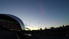 The Sage, Gateshead. The view across the Sage, Gateshead towards Newcastle upon Tyne at dusk.  The Tyne Bridge can be seen in the background 4k, 25fps stock video