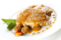Sage and rosemary spiked roast loin. Of pork with chestnuts Stock Photography