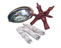 Sage smudge stick and bright polished rainbow abalone shell Royalty Free Stock Images