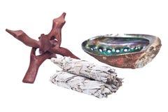 Sage smudge stick and bright polished rainbow abalone shell Stock Image