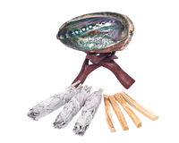 Sage smudge stick, rainbow abalone shell and palo santo smudging sticks Royalty Free Stock Image