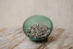 Sage tea plastic bowl. On table Stock Photo