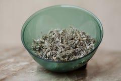 Sage tea plastic bowl. On table Stock Images