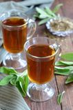 Sage tea on wooden background royalty free stock images