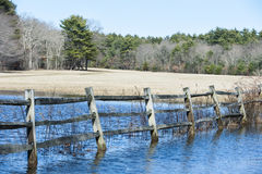 Sagging fence flooded field. Field flooded by heavy rains at Borderland State Park Stock Image