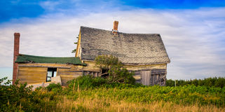 Sagging roof on an abandon house. Abandon house in rural Prince Edward Island stock image