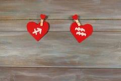 Sagittaire et Verseau signes du zodiaque et de coeur En bois Photo stock