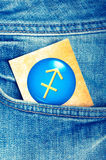 Sagittarius. Astrology card with zodiac sign of sagittarius in a blue jeans pocket Stock Image