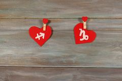 Sagittarius and Capricorn. signs of the zodiac and heart. wooden. Sagittarius and Capricorn. signs   of the zodiac and heart. wooden background. card. astronomy Royalty Free Stock Image