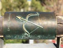 Sagittarius metal astrological sign on Wishing Bridge in Old City of Yaffa Israel. English and Hebrew metal sagittarius astrological sign on Wishing Bridge in royalty free stock photos