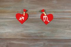 Sagittarius and scorpion. signs of the zodiac and heart. wooden. Background. card. Love. unusual handwork Stock Image
