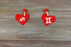 Sagittarius and twins. signs of the zodiac and heart. wooden bac. Sagittarius and twins. signs  of the zodiac and heart. wooden background. card. Love. unusual Royalty Free Stock Photos
