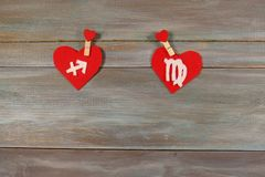 Sagittarius and the virgin. signs of the zodiac and heart. woode. Sagittarius and the virgin. signs  of the zodiac and heart. wooden background. card. astronomy Stock Photography