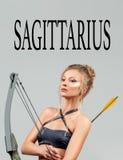 Sagittarius Zodiac Sign. Beautiful woman with bow and arrow. Astrology. Sagittarius Zodiac Sign. Beautiful amazon woman with bow and arrow Royalty Free Stock Photos