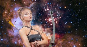 Sagittarius Zodiac Sign. Beautiful woman with bow and arrow. Beautiful woman with bow and arrow. Sagittarius Zodiac Sign. on night sky background stock photo