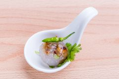 Sago balls filled with minced pork and sweet pickled radish serv Royalty Free Stock Photography