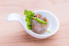 Sago balls filled with minced pork and sweet pickled radish serv Stock Photography