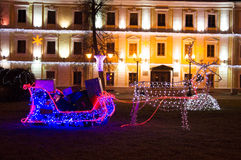 Sagolikt hjortjulljus kom med vagngåvorna Royaltyfri Bild