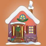 Sagolikt hus med julpynt. Arkivfoto