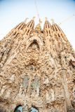 Sagrada Família, Barcelona, Spain. With 3 cranes hanging over Royalty Free Stock Photo