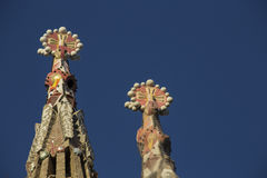 Sagrada famila towers ornaments. Barcelona, Spain - September 21, 2015: Two of the temple of  the Sagrada Famila towers ornaments.  Gaudi's profound catholicism Stock Images