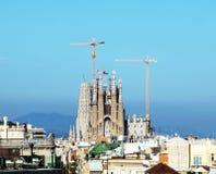 Sagrada Familia in Barcelona. The basilica of Sagrada Familia in Barcelona with tower cranes around it stock image