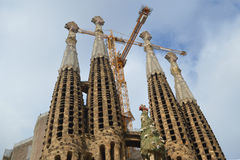 Sagrada Familia. In Barcelona center captivates with its extremely high towers and adorned with bows. Cathedral commissioned by the project by famous Spanish Royalty Free Stock Images