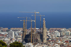 Sagrada Familia Barcelona Distant View. Sagrada Familia cathedral seen from a far away hill. This is a Catholic Cathedral under construction started by Gaudi and Stock Photography
