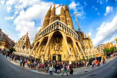 Sagrada Familia in Barcelona. Fish-eye lens view of tourists walking past the Sagrada Familia in Barcelona, Spain Royalty Free Stock Photos