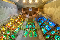 Sagrada Familia of Barcelona in Spain, Europe. BARCELONA, SPAIN - MAY 14: stained windows of Sagrada Familia. One projection anticipates construction completion Royalty Free Stock Photo