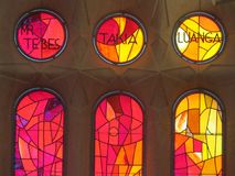 Sagrada familia cathedral colored window pane stained glass. Barcelona, Spain stock photo