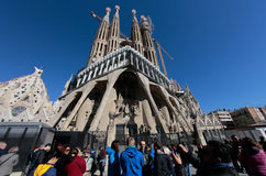 Sagrada familia cathedral front wide view. Tourists wait their queue near The Sagrada Familia cathedral designed by architect Antonio Gaudi, under construction Royalty Free Stock Images