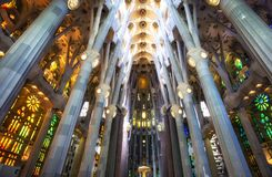 Sagrada familia cathedral interior. Tall columns line up the interior of sagrada familia with colorful lights from stained glasses. Taken in Barcelona, Spain royalty free stock images