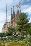 Sagrada Familia Church and Green Tree Tops Royalty Free Stock Photo