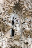 Sagrada Familia exterior, Nativity Facade. The Faith Portico, The finding in the Temple scene. Young Jesus is speaking wisely with the priests of the Temple stock photography