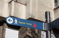 Sagrada Familia sign. A street sign in Barcelona which shows the way to Sagrada Familia, the famous church design by Antoni Gaudi Stock Photo