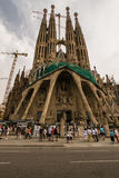 Sagrada Familia and tourists. The Sagrada Familia cathedral under construction and tourists Royalty Free Stock Photo