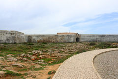 Sagres fortress in rugged terrain Royalty Free Stock Photo