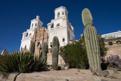 Saguaros in front of san xavier mission tucson arizona. The san xavier del bac mission wit saguaros in front in tucson arizona usa Royalty Free Stock Photography
