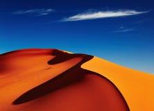 Sahara Desert, Algeria. Sand dune in Sahara Desert at sunset, Tadrart, Algeria Royalty Free Stock Image