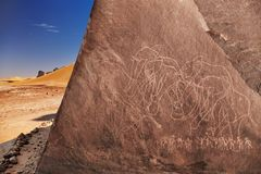 Sahara Desert, Algeria. Ancient rock engraving in Sahara Desert, Tadrart, Algeria royalty free stock photography
