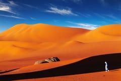 Sahara Desert, Algeria. Tuareg in desert at sunset, Sahara Desert, Algeria Royalty Free Stock Photo