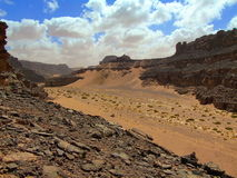Sahara desert hills, valley and clouds stock photo