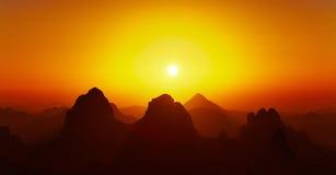Sahara Desert, Hoggar mountains, Algeria. Sunrise over Sahara Desert, Hoggar mountains, Algeria Royalty Free Stock Photography