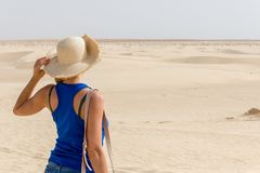 Young girl looking into distance in Sahara Desert, Tunisia, Africa royalty free stock photo